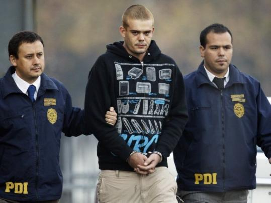 Chilean authorities escorted Joran van der Sloot yesterday out of a police station in Santiago, Chile, to be flown back to the Peruvian border. He faces charges in a woman's killing.