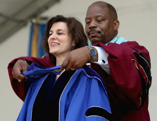 Victoria Reggie Kennedy received an honorary doctor of laws degree yesterday from the UMass chancellor, J. Keith Motley.