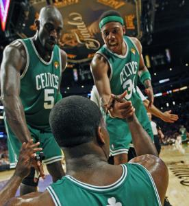 The Celtics supported each other all night, like when Kendrick Perkins was helped up by Paul Pierce and Kevin Garnett.