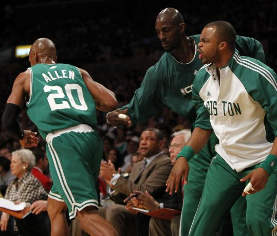 After hitting one of his seven first-half 3-pointers, Ray Allen gets kudos from Kevin Garnett and Shelden Williams (right).