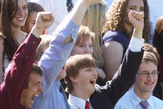 "Zack McLeod (center) cheers at BB&N's senior picture. ""Zack is the nicest kid who ever went to this school,'' said co-class president Emma Sagan."