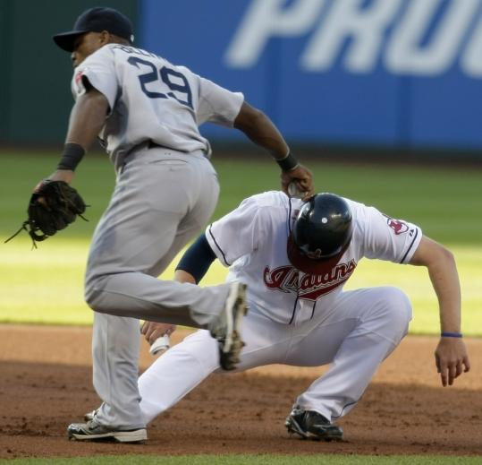 Red Sox third baseman Adrian Beltre applies the tag the Indians' Austin Kearns, who was caught in a rundown in the first inning.