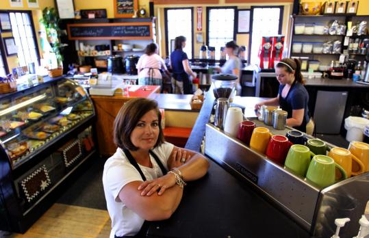 Lorraine Carboni of Somethin's Brewin' Book Cafe received threats of lawsuits.