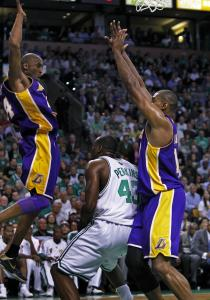 Kobe Bryant (left) and Andrew Bynum catch Kendrick Perkins in a Lakers sandwich.