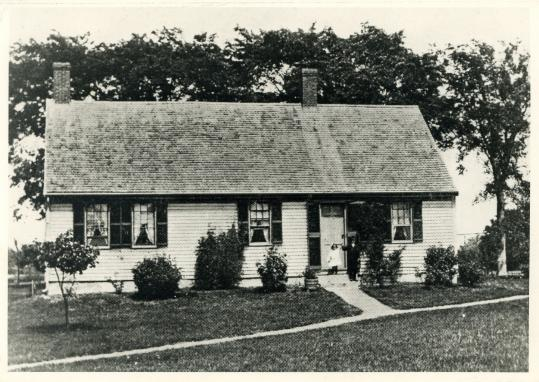 In a 1910 postcard, 10th generation descendants Alice and John Tower are shown at door at the 1664 Tower Homestead.