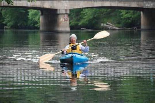 Marion Stoddart paddles on the Nashua River last summer during filming of a documentary about her pioneering environmental efforts.