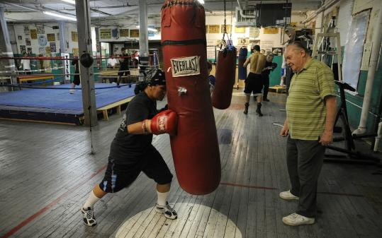Owner Art Ramalho watches JBunthy Chhiu-Lim work out at his West End Gym.