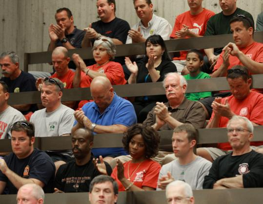 The City Council chamber was full yesterday as many were on hand for the council's vote on a contract for city firefighters. The council voted 12-to-1 to approve the contract.