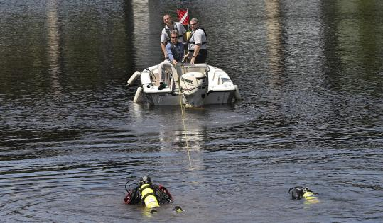 State Police divers searched the Charles River for any sign of the pipe connector responsible for last month's water main break. Officials fear continuing to dig may cause more problems.
