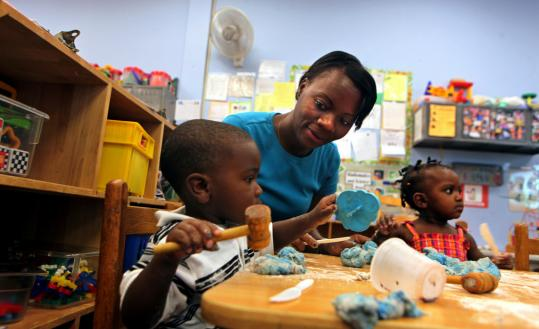 "Rose Podier with Cassius William and Safiya Allen at Castle Square, a child care and preschool program in the South End. ""We are like teachers, nurses, and social workers,'' Podier said."