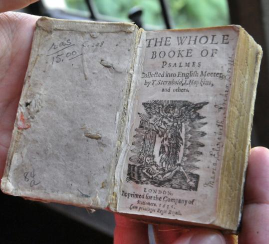 Hard economic times may force the Washington National Cathedral to sell off part of its rare books collection worth millions, including this book of psalms dating back to 1635.
