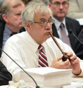 Representative Barney Frank led a Senate-House conference to merge competing financial bills.