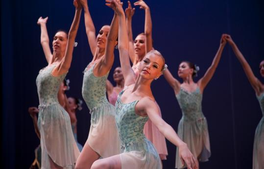 Whitney Jensen (center) in Boston Ballet's production of George Balanchine's 'Ballo della Regina' at the Teatro Coliseum in Barcelona this week. The tour stops in six cities over five weeks.