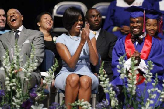 Michelle Obama with valedictorian Jordan Smiley during The Academies at Anacostia graduation yesterday in Washington.