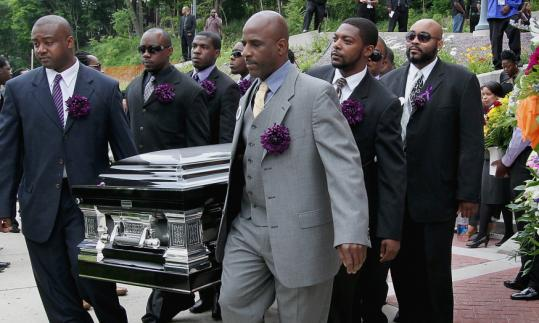 The casket bearing Ivol Brown, 17, was carried out of Morning Star Baptist Church in Mattapan yesterday.