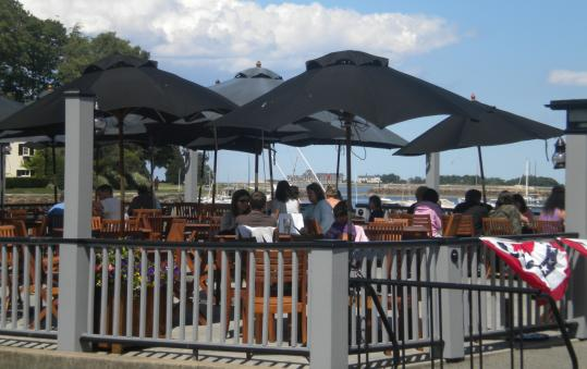 The deck of the Olde Salt House offers a gorgeous view of a cove on Cohasset Harbor.
