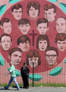 A mural in Londonderry, Northern Ireland, shows the 14 victims of the 1972 Bloody Sunday clash with British soldiers. The results of an inquiry on the killings will be released Tuesday.