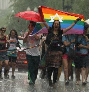 Hundreds of thousands of people  turned out to watch the parade yesterday and few people seemed deterred  by the downpour. Among those who braved the elements was the Rev.  Stephanie Spellers (top, right) of The Cathedral Church of St. Paul and  an enthusiastic Lisette Murphy (bottom, right) of Jamaica Plain.