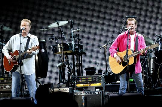 The Eagles' Don Henley (above left) and Glenn Frey headlined a rainy Saturday night triple bill at Gillette Stadium.
