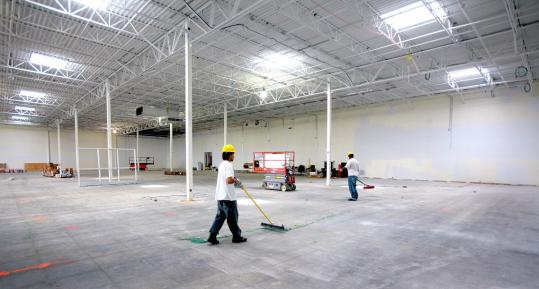 Workers swept the interior of the new Best Buy store set to open at Colony Place in Plymouth.
