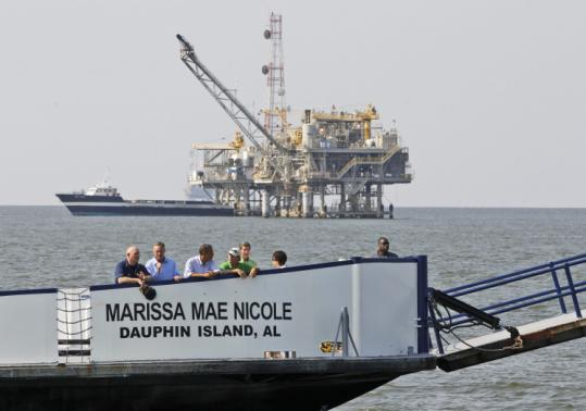 President Obama took a ferry past a natural gas rig en route to Fort Morgan, Ala., yesterday.