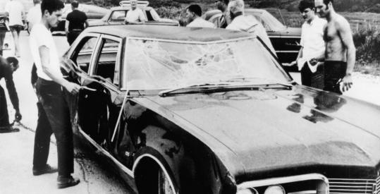 Bystanders examined the car driven by Edward M. Kennedy, recovered off Chappaquiddick.