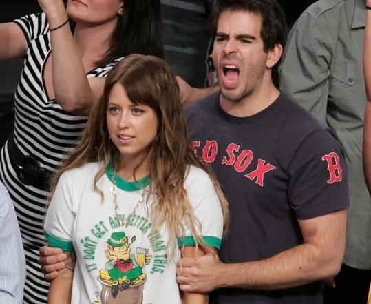 Peaches Geldof and Eli Roth (left) and Maria Menounos and Dane Cook show their colors at Game 6.