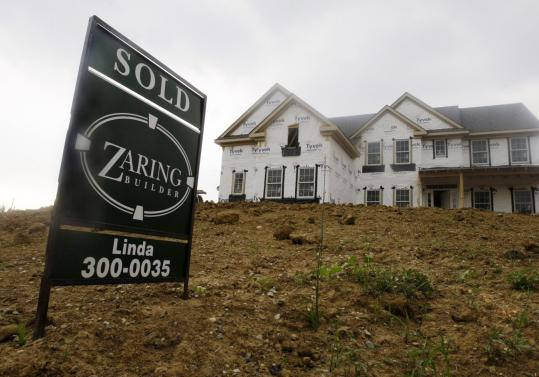 New home and apartment construction fell 10 percent in May to a seasonally adjusted annual rate of 593,000, the Commerce Department said yesterday. April's figure was revised downward to 659,000.