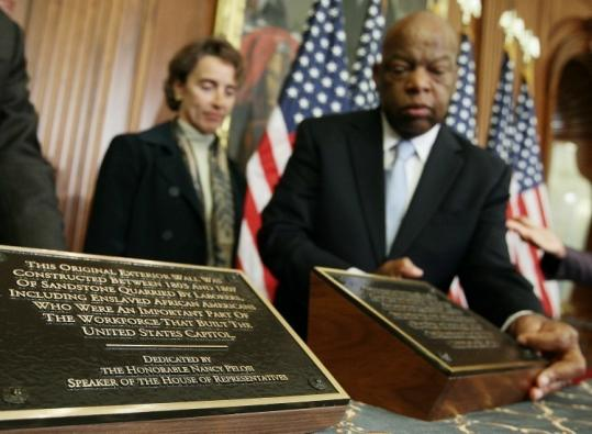 Representative John Lewis and Senator Blanche Lincoln looked at plaques unveiled yesterday that recognize the slaves who helped build the Capitol in Washington.
