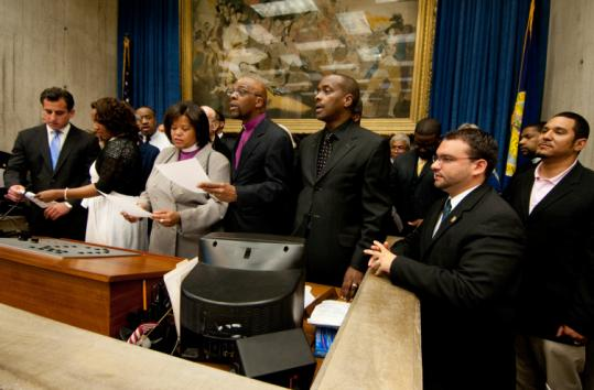 City councilors and local clergy held an interfaith prayer service for peace at City Hall yesterday to signify Boston's seriousness of purpose about addressing youth violence.