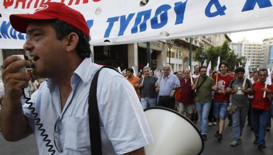 John Kolesidis/Reuters Members of the communist's labor union marched against the government's austerity measures in Athens yesterday.