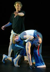 Choreographer Jonathan Wolken (in back) with dancers Mark Fucik and Renee Jaworski in New York's Joyce Theater in 2004.