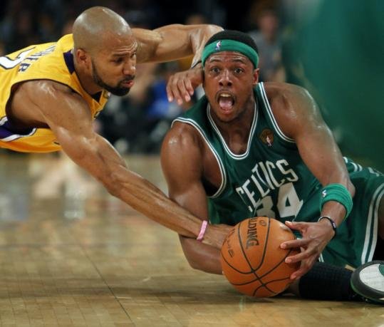 Paul Pierce hit the deck to keep possession and took a hit from Derek Fisher