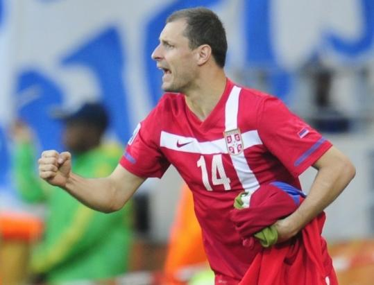 Serbian midfielder Milan Jovanovic, the game's only goal scorer, celebrates after his team beat Germany.