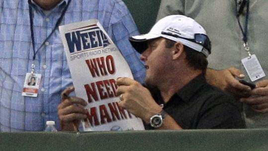 "Former Sox pitcher Roger Clemens holds up a sign reading ""Who Needs Manny'' at Fenway."