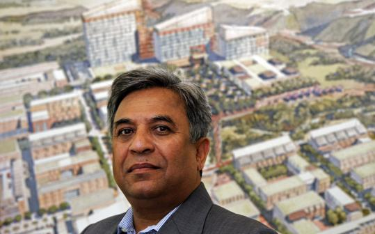 Shahid Ahmed Khan, a Framingham businessman and fund-raiser for Senator John F. Kerry, stood in front of a drawing of his proposed hospital complex in Islamabad, Pakistan.
