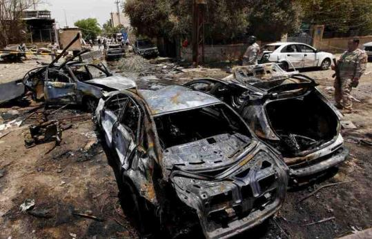 Suicide bombers detonated two cars packed with nearly 180 pounds of ammonium nitrate at the Trade Bank of Iraq in Baghdad yesterday. There were conflicting reports of casualties but bank officials said dozens of people were killed in the attack, including five guards and six other people in the bank.