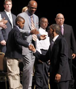 FATHERHOOD INITIATIVE — President Obama greeted audience members yesterday after speaking about fatherhood at an event at the Town Hall Education Arts and Recreation Campus theater in Washington. Obama announced plans to help promote responsible fatherhood.