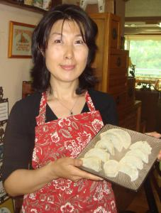 Bockhee Lee with a plate of mandu, Korean dumplings that her family has enjoyed through several generations.
