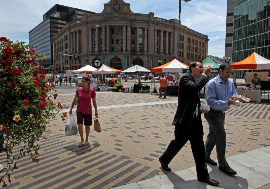 "Low-income residents can now use their electronic benefit transfer cards to get money back when shopping at the Dewey Square farmers' market (above). Mayor Menino imagines the market as a ""gathering place for people in our city to come together.''"