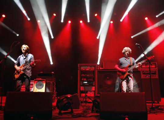 Guitarist Trey Anastasio and bass player Mike Gordon helped keep Phish on track at the Comcast Center in Mansfield last night.