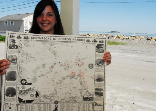 Victoria Stevens, Hull Lifesaving Museum curator, with the chart that inspired a website devoted to Boston-area shipwrecks.