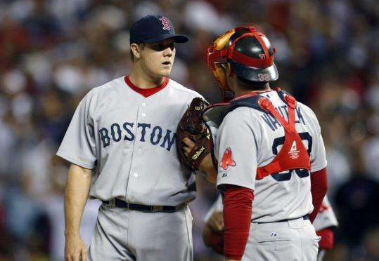 Jonathan Papelbon talks to Jason Varitek after giving up a tying HR in the ninth. It got worse.