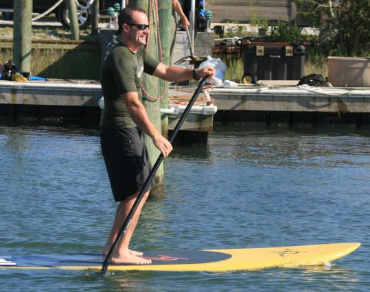 Patrick Dolan paddles in Beaufort, N.C. Stand-up boards are wide and long for stability.