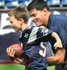 TJ Bruschi outruns his dad, Tedy, at the former Pats linebacker's annual minicamp for children at Gillette Stadium.