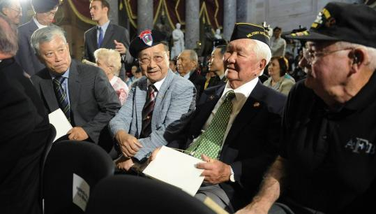 KOREAN WAR REMEMBRANCE — Veterans (from left) In Kyu Chang, Ki Chan-so, Grant Ichikawa, and Daniel Hughes commemorated the 60th anniversary of the start of the Korean War yesterday at the US Capitol in Washington.