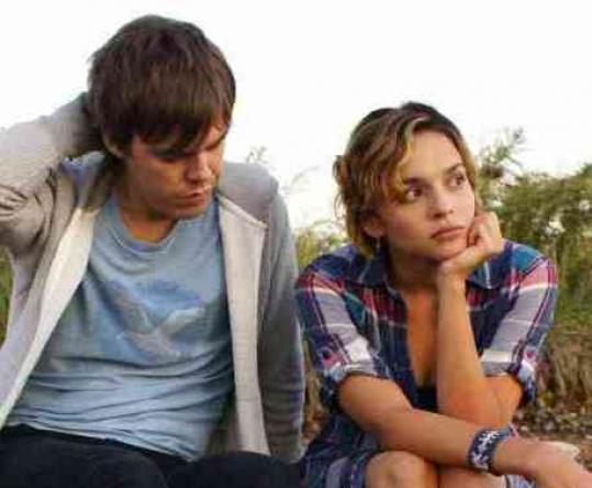 Sean Bones (with Norah Jones) plays a hipster who gets stranded in Jamaica.