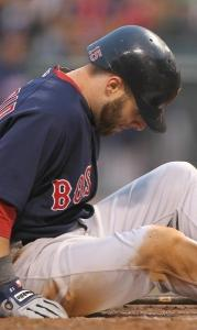 Dustin Pedroia was down after fouling a pitch off his foot, and out moments later.