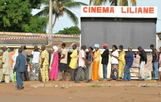 Voters waited outside a polling station in Conakry yesterday to cast their ballots. General Sekouba Konate, a junta leader, ordered elections after his predecessor was shot in December.