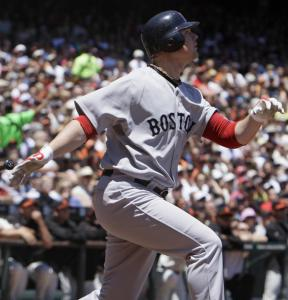 Sox pitcher Jon Lester hits a sacrifice fly off Tim Lincecum in the second.